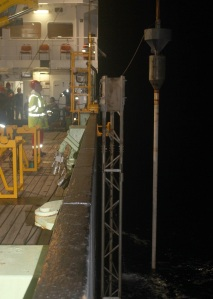 Night-time recovery of the 12m long piston coring rig.